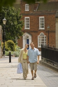 Couple walking hand in hand through St Albans, St Albans, Hertfordshire, England.